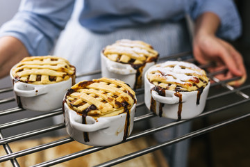 chef holding baked apple pies