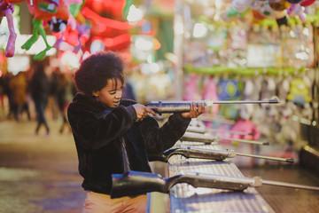 Black woman shooting in amusement park