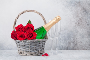 Red rose flowers bouquet and champagne