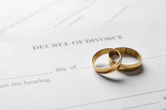 Rings with decree of divorce, closeup