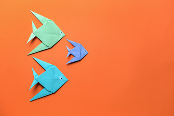 Origami fish on color background Wall mural