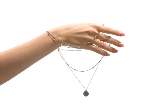 Female hand with stylish necklace on white background