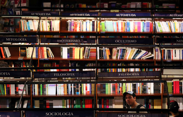 A man looks at books at El Ateneo Grand Splendid bookstore in Buenos Aires