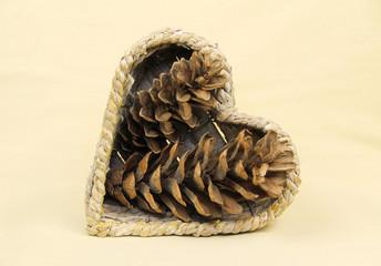 several cones arranged in the wicker basket shaped like heart