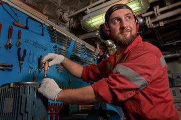 Closeup of auto mechanic. Auto repair service. Working tools background. Auto repair garage.