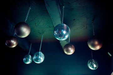 Disco ball fixed to the ceiling, night party.