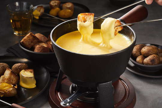 Delicious melted cheese fondue with dipping forks
