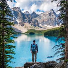 Hiker at Moraine Lake in Banff National Park, Canadian Rockies, Alberta, Canada.