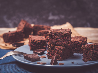 closeup of homemade brownies decorated with chocolate