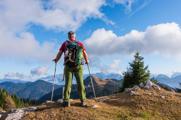 hiker with backpack is stand on mountain top