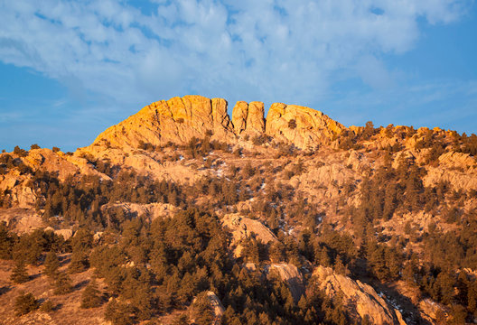 Horsetooth rock formation at sunrise is a distinctive geological and popular mountain landmark overlooking Fort Collins, Colorado, USA