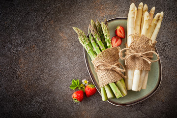 Fresh harvest of asparagus and strawberries