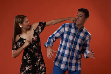 Young man and woman fighting
