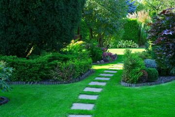 Fototapeta Beautiful lawn and path in a garden obraz