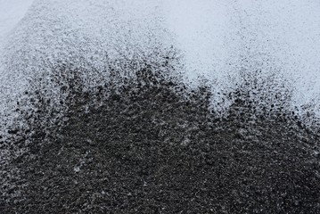 black white texture of ash and snow outside