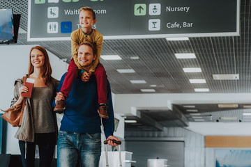 Wall Mural - Delighted parents with son are waiting for trip by plane