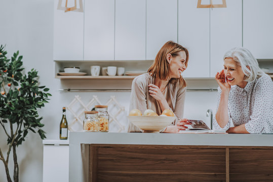 Mom and daughter are having fun in kitchen