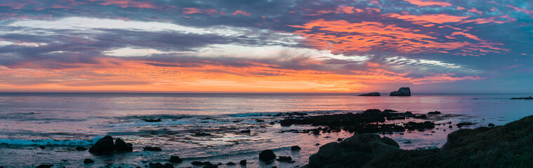 Dramatic sunset on the Pacific Ocean coastline near San Simeon, California
