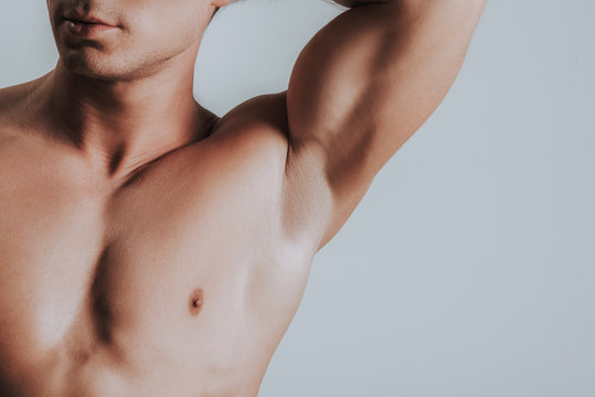 Close up of man showing his armpit while putting arm up
