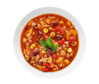 Bowl with tasty chili con carne on white background, top view