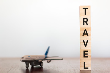 Airplane and Travel word written on wooden blocks