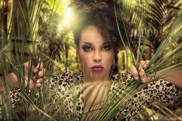 Afro girl in the jungle.