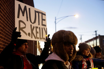 Demonstrators gather outside a music studio to show support for survivors of sexual abuse in Chicago