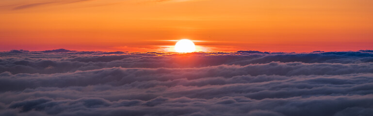 Panoramic view of a fiery sunset over a sea of clouds covering San Francisco bay area, California Wall mural