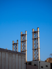 Big metal industrial chimney stacks