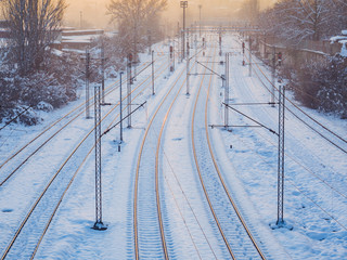 Empty train tracks covered in snow