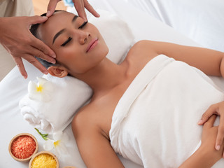 Asian girls are a relaxing facial massage in the Spa Salon. Thai massage for health