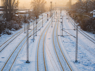 Snow covered empty train tracks