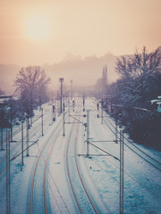 Misty evening over the empty train tracks in winter time