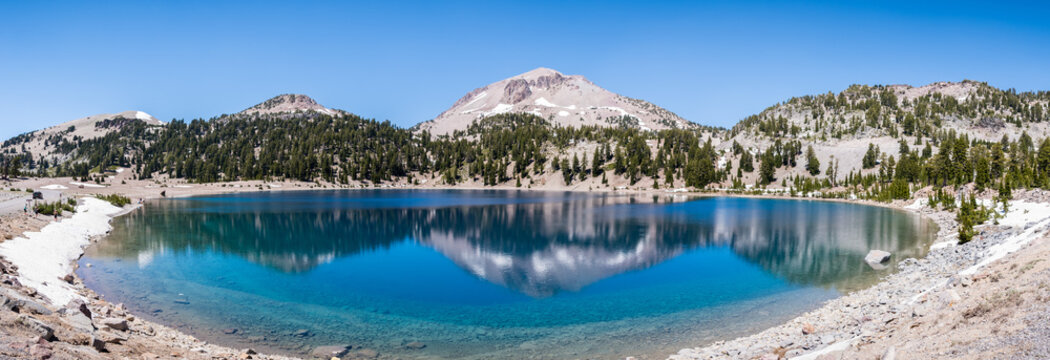 Surrounding mountains reflected in the calm waters of Lake Helen, Lassen Volcanic National Park, Northern California