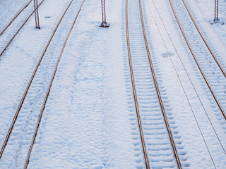 Snow covered empty train tracks in the winter time
