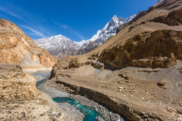 mountain lake under the sunny day with blue sky along Karakorum Highway in Passu, Hunza district of Pakistan