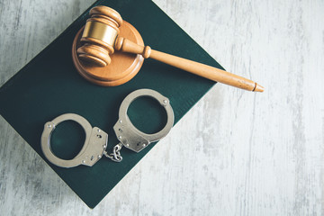 handcuffs and judge on books