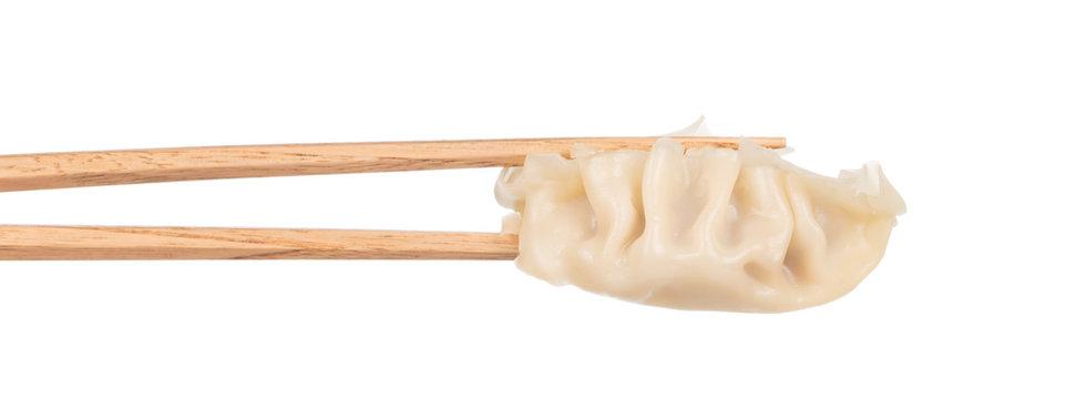 wontons with chopsticks isolated on white background.