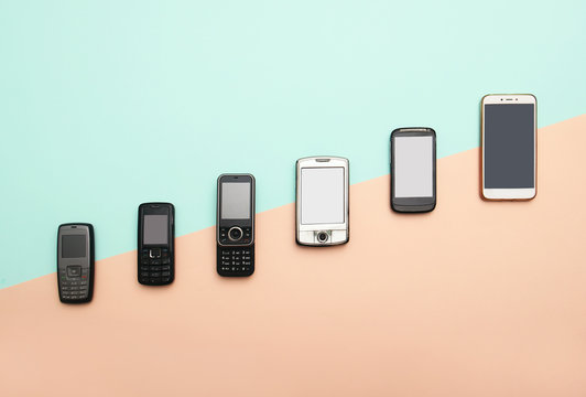 evolution of cell phones. Technology development telephone and pda concept. Vintage and new phones. Top view. Telephone communication progress, mobile classic device .