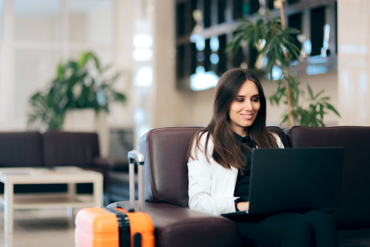 Woman with Laptop and Luggage in Airport Waiting Room