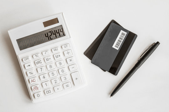 Credit card with calculator on white background