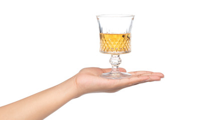 hand holding glass of brandy isolated on white background