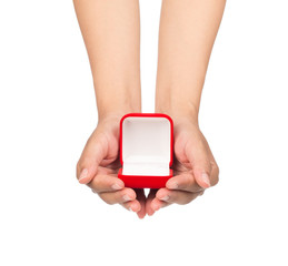 hand holding a Red velvet box for the ring isolated on a white background.