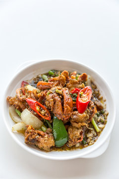 fresh soft crabs cooked in black pepper sauce on white backgroun