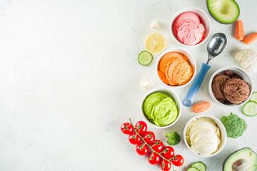 Trendy vegan food, summer healthy dessert concept, colorful diet vegetable ice cream with avocado, cucumber, tomato, beet, carrot, broccoli, cauliflower. Frozen veggie smoothie,  banner