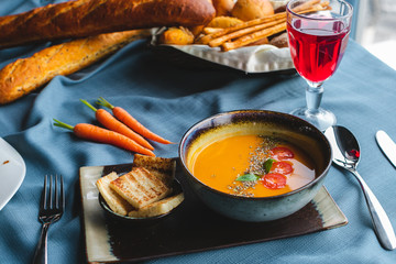 lentil soup with bread and herbs on the table. soup puree