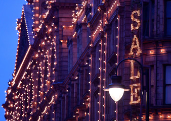 An illuminated sale sign is seen on the exterior of the Harrods department store in London, Britain