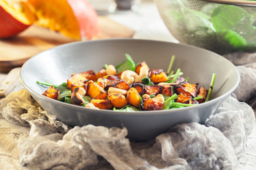 Roasted pumpkin salad with spinach and nuts