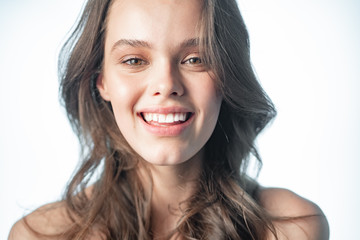 Close-up portrait of a girl with a beautiful smile