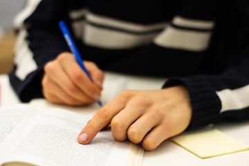 Hand writing on white paper. Education and business concept